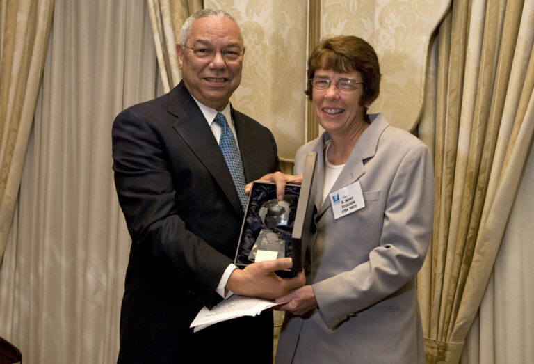 General Colin L. Powell, USA (Retired) bestows the award upon Sister Mary Scullion (USA '02)